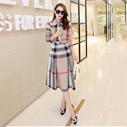 Wholesale 2019 весной и осенью новое женское платье в клетку с длинными рукавами А образный длинный осенний корейский вариант тонкого платья