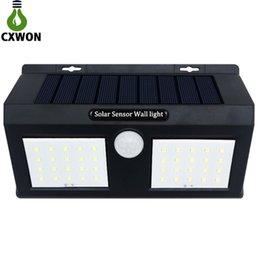 Lampade solari per pareti online-Smart Sensor e Solar Power 20 Lampada da parete a LED PIR Motion Sensor Lampada di sicurezza per esterni Lampada da parete da giardino impermeabile Luci paesaggistiche