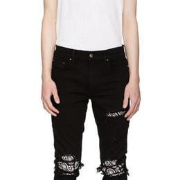 Jeans de flores de mezclilla online-18FW AM1R1 Flores de anacardo Agujero Pantalones de mezclilla negros Pantalones de chándal de lujo Calle Pantalones de hip hop Pantalones de mezclilla casual joven HFLSKZ106