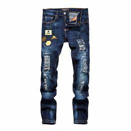 Argentina Hombres de calidad superior del cráneo del bordado flaco delgado Denim Moda Casual pantalones de mezclilla largos Hip Hop pantalones de los hombres cheap skull trousers Suministro