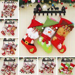 2019 santa claus decoraciones para árboles de navidad 12 estilos de regalo de Navidad Stocking Fashion Kids Santa Claus Candy Gift Bag Home Christmas Tree Hangin Decoration Xmas Storage Bag TTA1702 santa claus decoraciones para árboles de navidad baratos