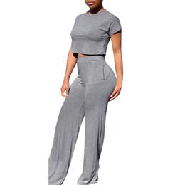 Casual solide top femmes deux pièces ensemble taille élastique pantalon long survêtement femmes manches courtes col rond costumes ? partir de fabricateur