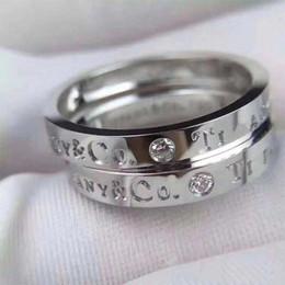 Joyería de boda clásica online-Titanio de acero Classic Sign T-Zircon Charm Ring Rose Gold silver couple ring anillo de boda Regalo Joyas originales para mujeres y hombres