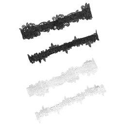 2 Unids / set Mujeres Boda Pierna Nupcial Ligas Color Sólido Negro / Blanco Flor de Encaje Ahueca hacia fuera Bordado Elástico Muslo Anillos De Goma desde fabricantes