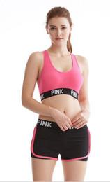 Correa de sujetador ajustable online-Yoga para mujer Sujetadores de gimnasio Ejecución de camisas deportivas Push Up Sujetador Fitness Tops Correa ajustable Sujetador rosado