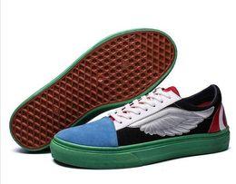 Gummischuhe flügel online-Casual Leinwand Vulkanisierte Schuhe Wings Student Red Bottom Skate Boarding Gummischuhe Wohnungen Design Sneaker Männer Zapatos Hombre # 229052