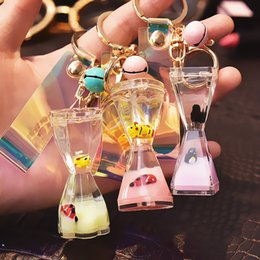 oil hourglass Promo Codes - uicksand Floating Marine Doll Hourglass Keychain Liquid Into Oil Drum Drift Bottle Couple Bag Pendant New Fashion
