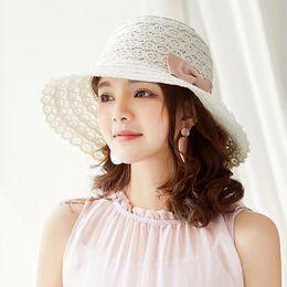 женские пляжные розовые шляпы Скидка HT1621 милые женские летние шляпы от Солнца сладкий розовым бантом пляжные шляпы дамы широкими полями дышащий полые компактный Панама