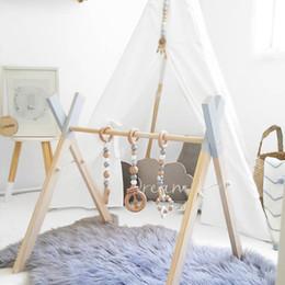 kleider spielzeug aus holz Rabatt Nordic Style Baby Gym Spielen Kindergarten Sensorische Ring-Pull Spielzeug Holzrahmen Säuglingszimmer Kleinkind Kleiderständer Geschenk Kinderzimmer