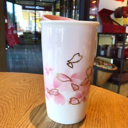 Starbucks café xícara cerâmica on-line-Starbucks Day Flor de cerejeira Palavra copo de café Rosa Sakura Dupla Cerâmica De Isolamento Caneca Que Acompanha copo para fora dooor no carro caneca 355 ML