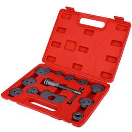 12pcs / Set Auto Universal Disc Pinza freno vento Torna freno Pistone compressore Tool Kit per la maggior parte Vetture Garage Strumenti di riparazione TOS_122 da dispenser per bottiglie di alcol fornitori