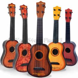 Cuerdas de guitarra clásica online-Mini 16 pulgadas Principiante Clásico Seguro simple Ukulele Guitarra 4 Cuerdas Educativo Musical Instrumento de Concierto de Juguete para Niños Regalo de Navidad