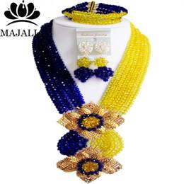 2019 ensemble de bijoux nigérians en perles jaunes Mariage nigérian perles africaines ensemble de bijoux cristal bleu et jaune collier boucles d'oreilles Une marque bien connue Majalia Y-40 ensemble de bijoux nigérians en perles jaunes pas cher