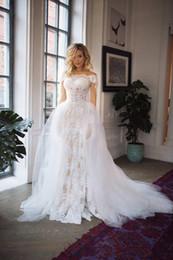 Novo estilo sereia vestidos de noiva de renda branca destacável saia trem nigéria barato praia vestidos de noiva vestidos de noiva china 2019 de Fornecedores de belos vestidos de casamento detalhados