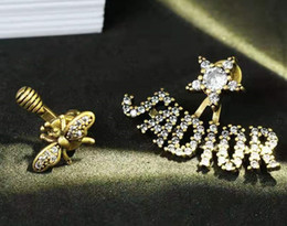 orecchini di celebrità Sconti Il nuovo alfabeto è un paio di orecchini asimmetrici retrò ape web per Ragazze