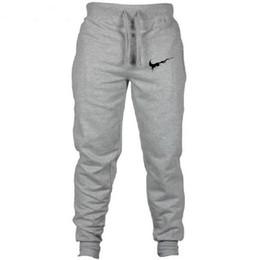 Nuevos pantalones de jogging impresos de algodón tipo camuflaje pantalones de harén de moda masculina Pantalones de primavera y otoño Pantalones de chándal de diseñador de marca desde fabricantes