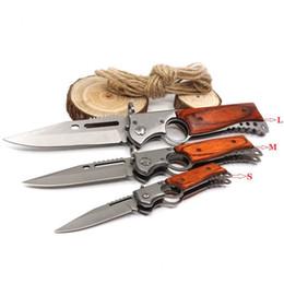 cuchillos ak47 Rebajas Nuevo estilo AK47 Pistola plegable del cuchillo de bolsillo táctico del cuchillo que acampa al aire MultiTool supervivencia cuchillos con luz LED EDC Herramientas