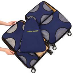 5 set di imballaggio cubetti, 4 varie dimensioni bagaglio da viaggio Organizzatori di imballaggio +1 sacchetto della lavanderia da mano a maglia di paglia fornitori