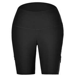 Pantalones de yoga de cintura alta para mujeres Bolsillos laterales para teléfonos celulares Gimnasio Pantalones de yoga Entrenamiento Cintura media Pantalones de correr A1 desde fabricantes