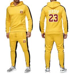 Nouveau style décontracté costume à capuche pour hommes Euramerican Fitness en plein air Survêtements de mode Spell Couleur Sport Running Vêtements