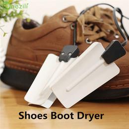 Scaldino elettrico dei guanti dei calzini dell'essiccatore dello stivale dell'essiccatore delle scarpe di cottura del riscaldatore elettronico portatile bianco di plastica caldo all'ingrosso di trasporto 220V da