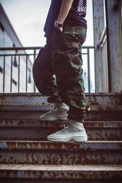 tênis de marca de luxo mens Desconto Designer de bota de deserto Kanye Martin botas de moda de luxo 2019 sapatos de marca estrela homens botinhas Tênis para homens formadores ao ar livre
