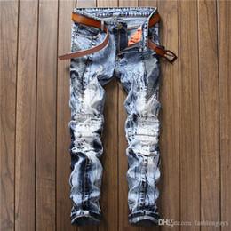 Ragazzi blu jeans lavati online-Jeans da uomo in Europa e negli Stati Uniti fiocco di neve da uomo lavano piccoli jeans dritti blu strappati pantaloni di personalità per ragazzo