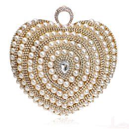 Bolso del día de la boda de la novia online-Bolsos de novia de la boda Bolso de lujo Bolso de diamantes con cuentas Bolsas de noche Rhinestones Día Embragues Diseño de corazón Bolso de perlas