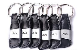 tampa da chave renault Desconto Carro do emblema do emblema preto geniue Couro Cadeia Car Key Ring para Audi A3 A4 A5 A6 A7 Q3 Q5 Q7 TT KeyChain Chaveiro Keyfob Car Styling
