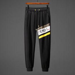 pantalones de jogging amarillo hombres Rebajas 19 italianos Pantalones de chándal de marca larga de los hombres pantalones de chándal amarilla impresa Pantalones de chándal de moda del basculador 9086M-XXXL