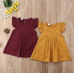 vestidos amarillos sólidos Rebajas Vestido de verano amarillo borgoña bebé niñas Casual Princess Party Tutu vestidos niños ropa Color sólido breve estilo vestido niños Boutique