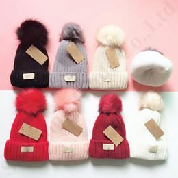 Sombreros para la nieve online-Diseñador Pom Fleece Gorros UG esquí Caps las mujeres caliente del invierno de esquilado Sombrero deporte al aire libre de la gorrita tejida del sombrero del ganchillo lujo de esquí Snow Cap 7color C91101