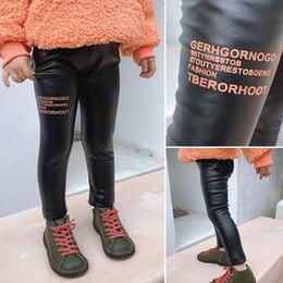 Nuovo cuoio dell'unità di elaborazione delle ragazze delle ghette delle ragazze Collant per bambini Collant ragazze Pantaloni per bambini i pantaloni scarni A8930 da