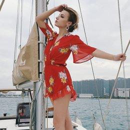 Costume da donna tutina pagliaccetti Sexy Flora stampa casual abiti da vacanza vocazione rossa New Fashion Night Club abiti da festa Chiffon Playsuits da