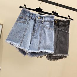 Pantalones vaqueros grises Pantalones cortos Mujer Verano Pantalones cortos de mezclilla rasgados 2019 Nuevas señoras coreanas flojas del tamaño extra grande pantalones S-5XL desde fabricantes