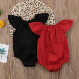 corti pantaloni neri Sconti 2019 new fashion Neonato Bambino Neonate Vestiti Pagliaccetto Manica Corta Tuta Tuta Casual Solid Nero Rosso Abbigliamento Per Bambini Outfits 0-24 M