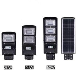 Luci solari a parete all'aperto online-Nuovo LED Solar Street Light 20W 40W 60W Sensore di movimento PIR controllo della luce IP67 Impermeabile solare applique da parete per esterni con palo di montaggio