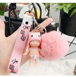 Nueva llegada Baby Doll llavero para hombre mujer decoración vestido coche colgante de goma material de silicona llavero anillo anillo de la aleación gota-envío desde fabricantes