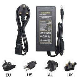 источник питания 12v au 5a Скидка Высокое качество 12V 5A 60W Блок питания AC100-240V к адаптеру постоянного тока Великобритании / США / ЕС / AU для 3528 5050 5630 светодиодных лент