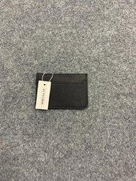 Carteras de cuero delgado para hombre online-Nuevo diseño clásico de moda para hombre, titular de identificación de tarjeta de crédito informal, bolsa de paquete de billetera ultra delgada de cuero real de alta calidad para hombres / mujeres con caja