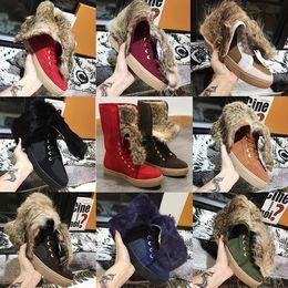 Argentina Las mujeres botines de invierno de piel de conejo real botas para la nieve zapatos de diseño de cuero real Australia clásico de rodillas planas botas con caja US11 cheap rabbit boots Suministro
