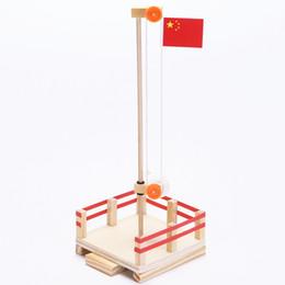Bandiere puzzle online-La tecnologia di esperimento di scienza degli studenti della scuola primaria piccolo di DIY bandiera piattaforma di sollevamento puzzle fatti a mano piccoli giocattoli di invenzione
