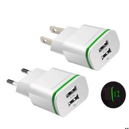 Geniales cargadores de iphone online-Cargador de pared Cool LED Doble cargador USB Puertos Adaptador de corriente de viaje en el hogar 5V 2.1A + 1A AC EE. UU. Enchufe de la UE para Samsung Huawei