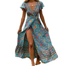 Nuevo vestido de verano Indie Folk 2019 Mujeres Sexy Impreso Bow Holiday Beach Dress con cuello en v manga corta femenina elegante partido M0511 desde fabricantes