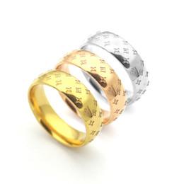 Jóias china 18k on-line-Designer de luxo jóias Clássico 18k anéis de ouro amor para as mulheres Titanium Aço Inoxidável Cambered flores gravadas anel de presentes de casamento jóias