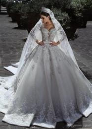 Argentina Vintage de lujo vestido de bola de manga larga de encaje africano más el tamaño vestido de boda musulmán con cuentas velo playa Zuhair Murad vestidos de novia H027 Suministro