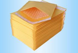 paquete pequeño para el envío Rebajas Bolsas de papel universales Pequeño Kraft Bubble Mailer Sobres acolchados Bolsas Mailers Paquete de paquete de envío de sellado automático Caja