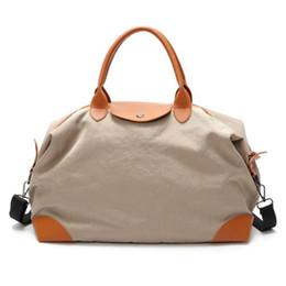 38f9c1ab68f4 Wohlbege Large Capacity Women Travel Bags Canvas Hand Luggage Traveling Bag  Women Weekend Travel Bag Handbags