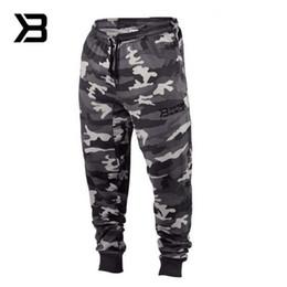 Otoño verano pantalones de camuflaje hombres sueltos de algodón ejército pantalones pantalones casuales de hip hop cargo pantalones de camuflaje hombres harén desde fabricantes