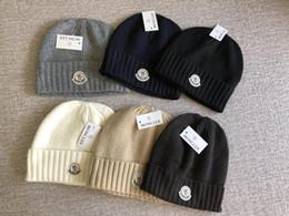 2019 delle donne cappelli abito invernale 2019 marca Inverno di lusso CANADA uomini beanie donne Bonnet Designer di moda casual maglia hip hop Gorros pom-pom cranio cappelli outdoor